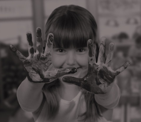 girl showing her hands with paints